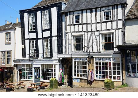 BURFORD, UNITED KINGDOM - JULY 20, 2016 - Shops in timbered buildings along The Hill shopping street Burford Oxfordshire England UK Western Europe, July 20, 2016.