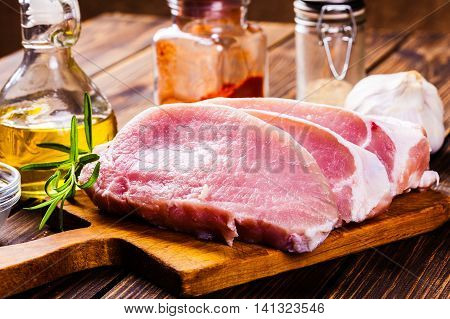 Raw Pork Slices On A Chopping Board