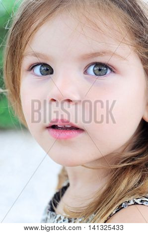 Close up portrait of a beautiful girl 3 years old straight look at the camera