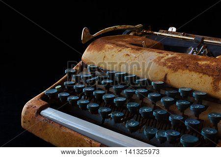 Typewriter Waiting for Inspiration. Vintage Rusty Typewriter Machine. Journalist Equipment. Typewriter Close Up Isolated on Black Background.