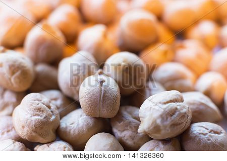 Chickpeas Close Up. Pile of Organic Uncooked Chickpeas. Gold Chickpeas Background. Healthy Vegan Food Hummus With Chickpeas. Selective Focus and Shallow Depth of Field.