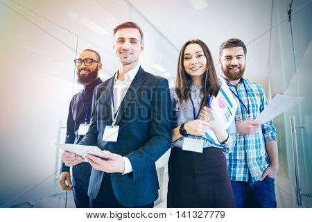 Group of business people with team leader standing in office