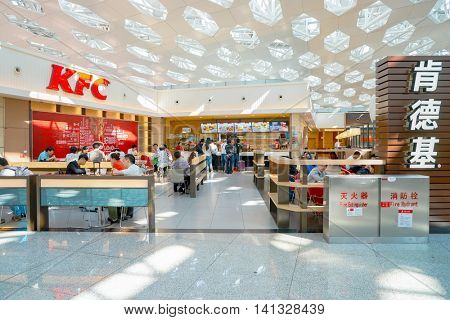 SHENZHEN, CHINA - MAY 11, 2016: KFC in Shenzhen Bao'an International Airport. Kentucky Fried Chicken, or simply KFC, is a fast food restaurant chain that specializes in fried chicken.