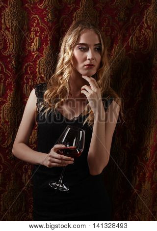 Beautiful Woman In Black Dress With Glass Of Red Wine