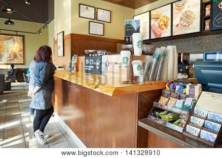 SHENZHEN, CHINA - MARCH 01, 2016: Starbucks in Shenzhen. Starbucks Corporation is an American coffee company and coffeehouse chain