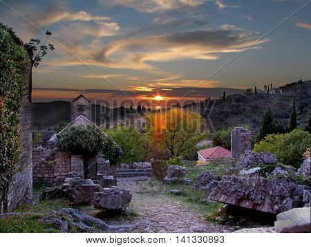 romantic sunset over the ruins of the castle Old bar Montenegro tourist attraction