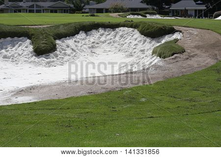 This is a close up image of a fairway sand trap taken on a sunny day.