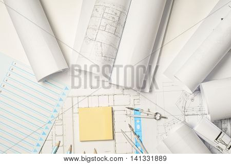 Workplace of architect - Architect rolls and plans.architectural plan, technical project drawing. Engineering tools view from the top. Construction background.