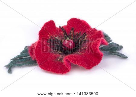 Brooch felted wool on a white background