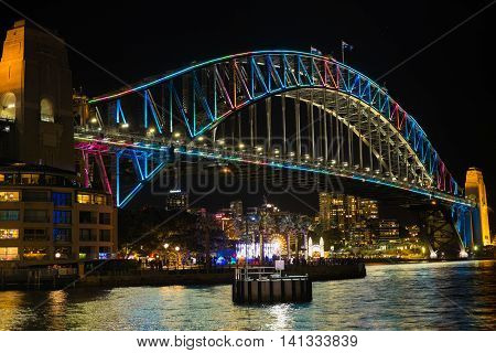 SYDNEY, AUSTRALIA - June 11, 2016: Sydney Harbour bridge during Vivid Sydney festival. Vivid Sydney is an outdoor annual cultural event featuring immersive light installations and projections.
