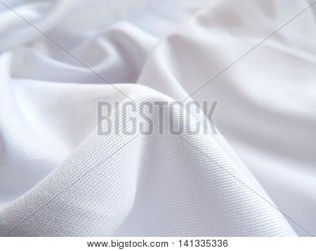 White cloth or textile, wavy textile, close-up shot.