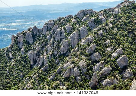 Conglomerate rocks in Montserrat mountains near Maria de Montserrat Abbey Spain