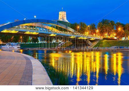 Night Gediminas Tower and King Mindaugas Bridge across Neris River in the city Vilnius, Lithuania, Baltic states.