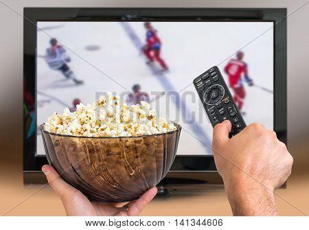 Man Is Watching Hockey Match On Tv