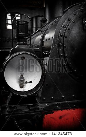 The front of an old, steam engine locomotive