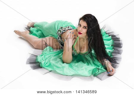Young beautiful exotic eastern women in ethnic green dress. Isolated on white background. Isolated on white background. Studio shot