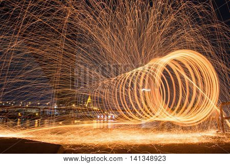 Burning steel wool spinner near the Bridge