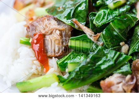 Stir fried kale with crispy pork and rice