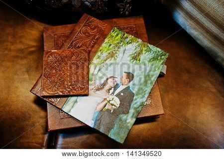 Brown leather wedding book and album at wedding