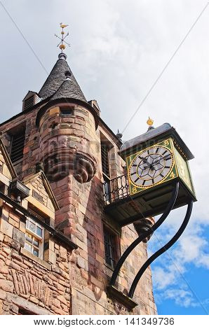 Bartizans and Clock of Canongate tollbooth in the Royal Mile of the Old Town of Edinburgh in Scotland. Edinburgh is the capital of Scotland in the United Kingdom.
