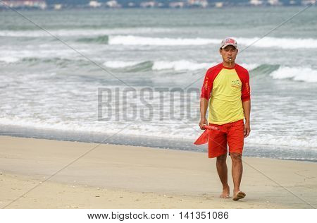 Beach Inspector Passing By At The China Beach Of Danang