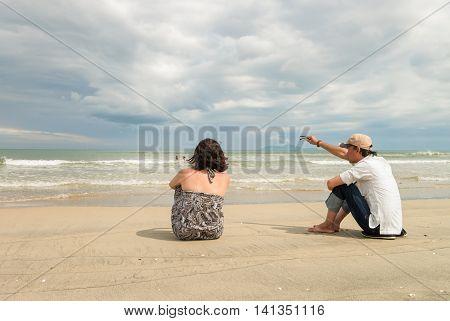 Man And Woman Looking Into Sea At China Beach Danang