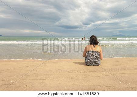 Woman Looking At The Sea At The China Beach Danang