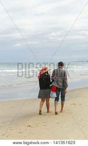 Young Couple Holding Hands At The China Beach Of Danang