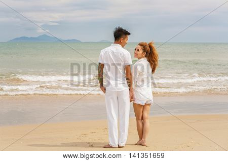 Young Couple Looking At Each Other At China Beach Danang