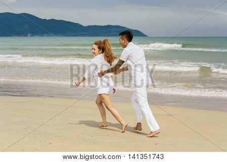 Young Couple Playing With Each Other At The China Beach