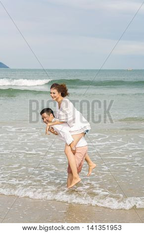 Young Couple Posing On China Beach In Danang In Vietnam