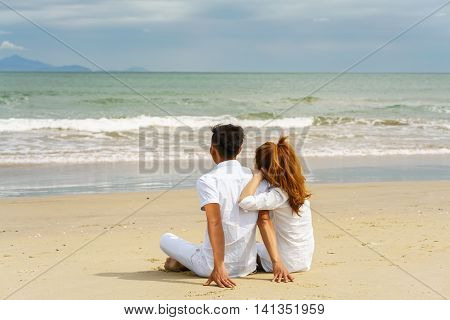 Young Couple Sitting And Looking At The Sea In Danang
