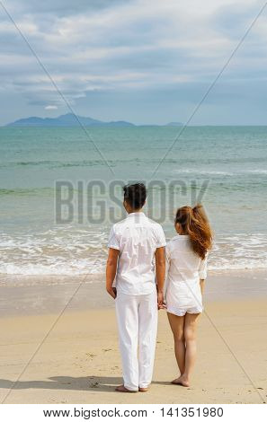 Young Couple Standing And Looking At The Sea Of Danang