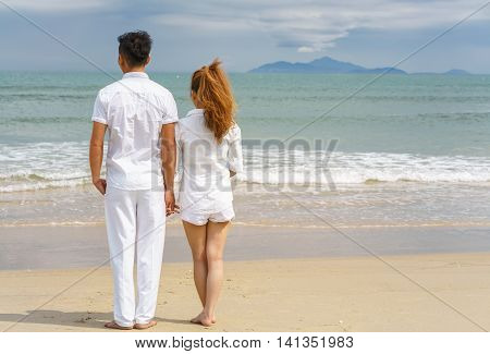 Young Couple Standing And Looking At The Sea In Danang