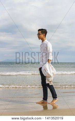 Young Fellow In China Beach Of Danang In Vietnam