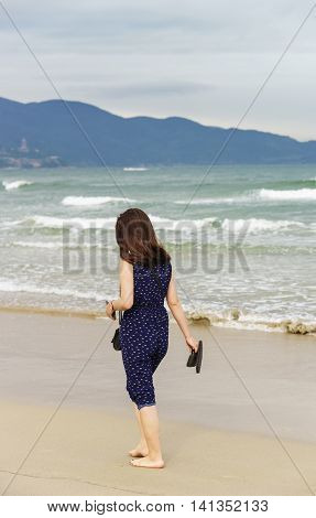 Young Girl Passing By In China Beach Danang