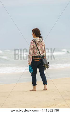 Young Girl Passing By At China Beach In Danang