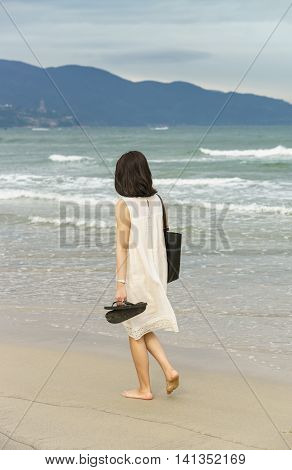 Young Girl Passing By On China Beach Of Danang