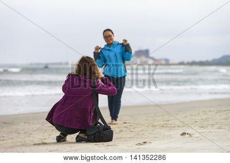 Young Girls Taking Photos In China Beach Danang