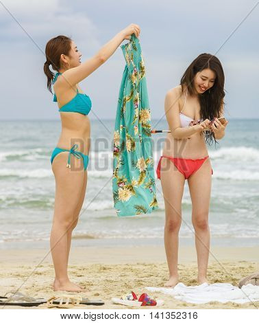 Young Girls With Mobile Phone  At China Beach In Danang