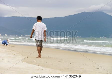 Young Man Passing By On China Beach Of Danang