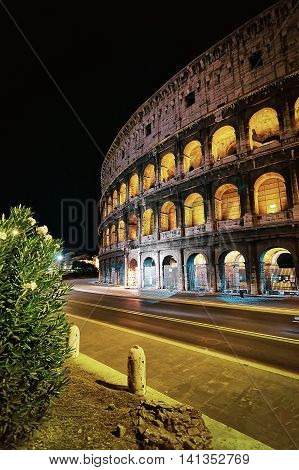Colosseum In The City Center Of Rome Italy At Dusk