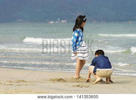 Small Children Playing At The China Beach In Danang Vietnam
