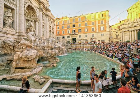 Tourists And Trevi Fountain In Rome In Italy