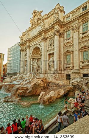 Tourists Near Trevi Fountain In Rome In Italy