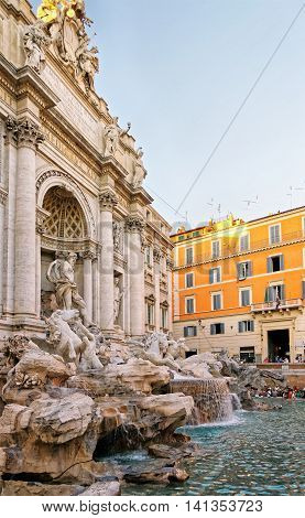 Trevi Fountain And Tourists In Rome In Italy