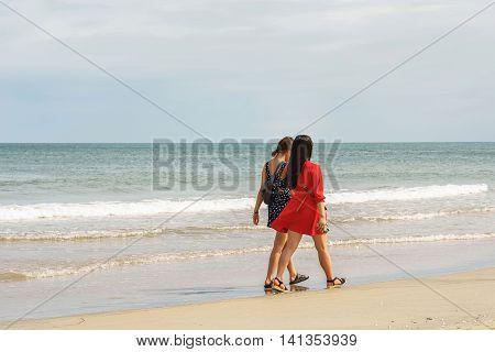 Young Girls Passing By At China Beach Danang