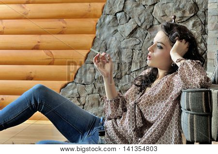 Beautiful Woman Smokes An Electronic Cigarette.