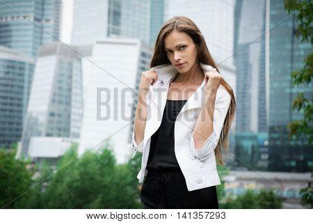 Woman Standing Near Skyscrapers