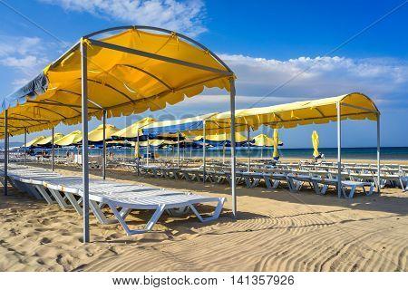 Beach sunbeds with a canopy from the sun